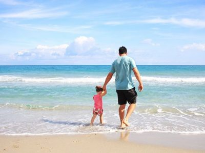 Dad and child on the beach